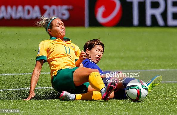 Kyah Simon of Australia challenges Azusa Iwashimizu of Japan for the ball during the FIFA Women's World Cup Canada 2015 Quarter Final match between...