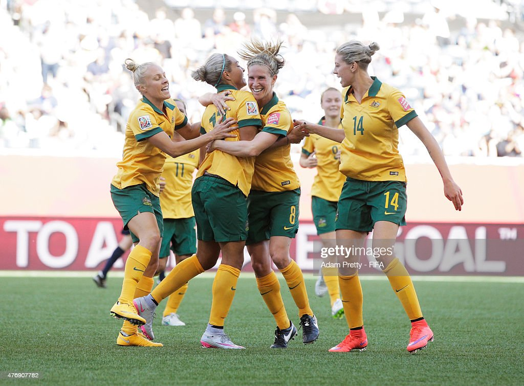 Kyah Simon of Australia is congratulated after scoring her second goal during the Group D match between Australia and Nigeria of the FIFA Women's World Cup 2015 at Winnipeg Stadium on June 12, 2015 in Winnipeg, Canada.