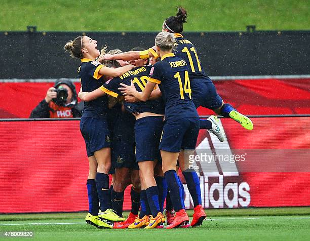 Kyah Simon of Australia is mobbed by team mates in celebration as she scores their first goal during the FIFA Women's World Cup 2015 round of 16...