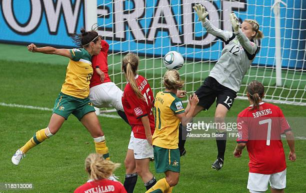 Kyah Simon of Australia scores a goal against goalkeeper Erika Skabo of Norway during the FIFA Women's World Cup group D match between Australia and...
