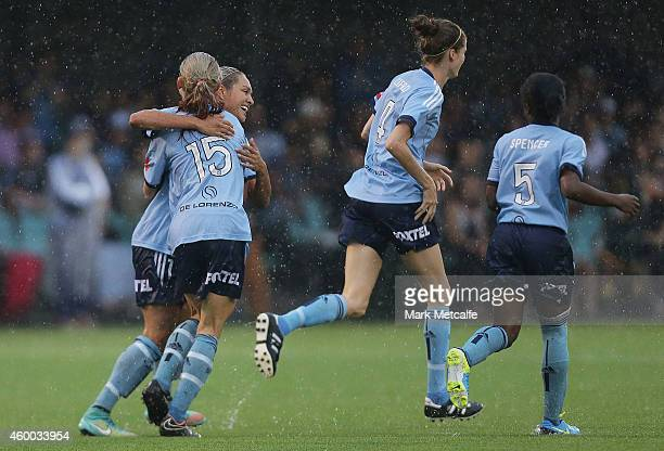 Kyah Simon of Sydney celebrates scoring a goal with team mates during the round 12 WLeague match between Sydney FC and Newcastle Jets at Lambert Park...