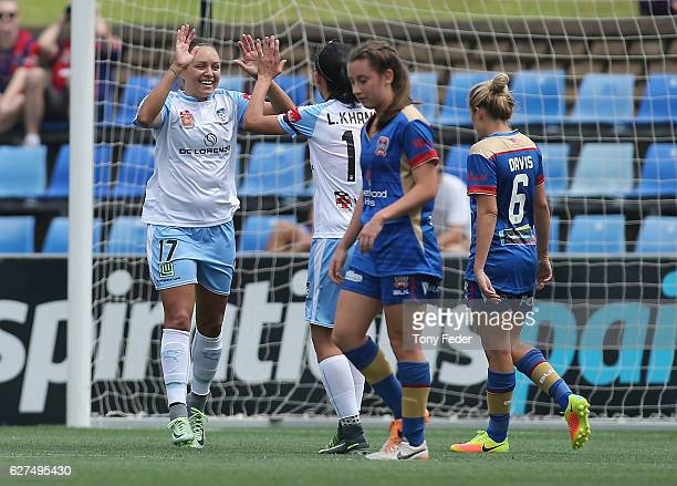 Kyah Simon of Sydney celebrates with team mate Leena Khamis during the round five WLeague match between the Newcastle Jets and Sydney FC at McDonald...