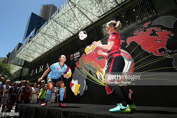 Kyah Simon of Sydney FC and Caitlin Cooper of the Wanderers juggle a football during the 2016/17 WLeague Season Launch on October 31 2016 in Sydney...