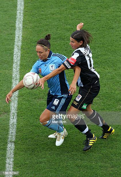 Kyah Simon of Sydney FC competes with Ariane Hingst of the Jets during the round 10 WLeague match between Sydney FC and the Newcastle Jets at...