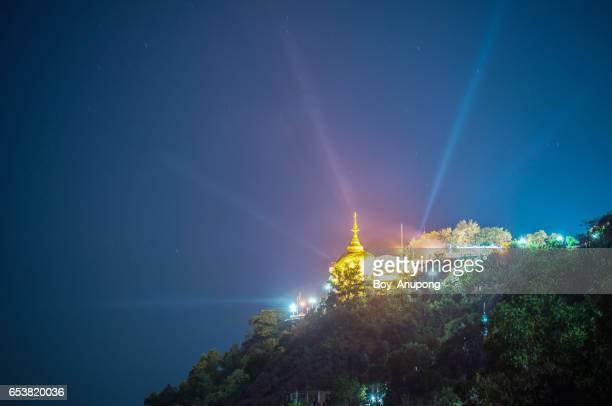 Kyaiktiyo Pagoda light up at night time.