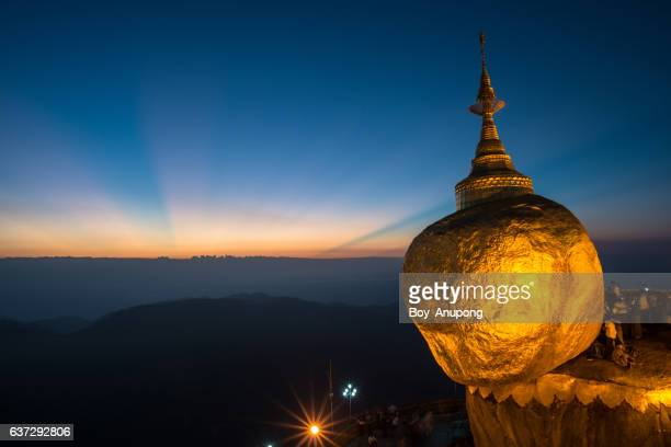 Kyaiktiyo pagoda one of the most amazing place in Myanmar during the beautiful sunset.