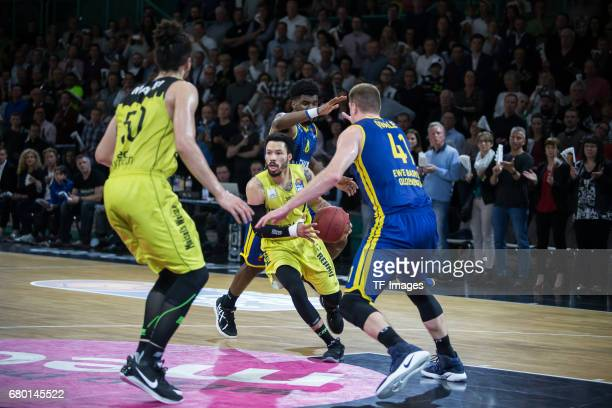 Kyan Anderson of medi bayreuth and Qvale of EWE Baskets Oldenburg battle for the ball during the easyCredit BBL match between medi bayreuth and EWE...
