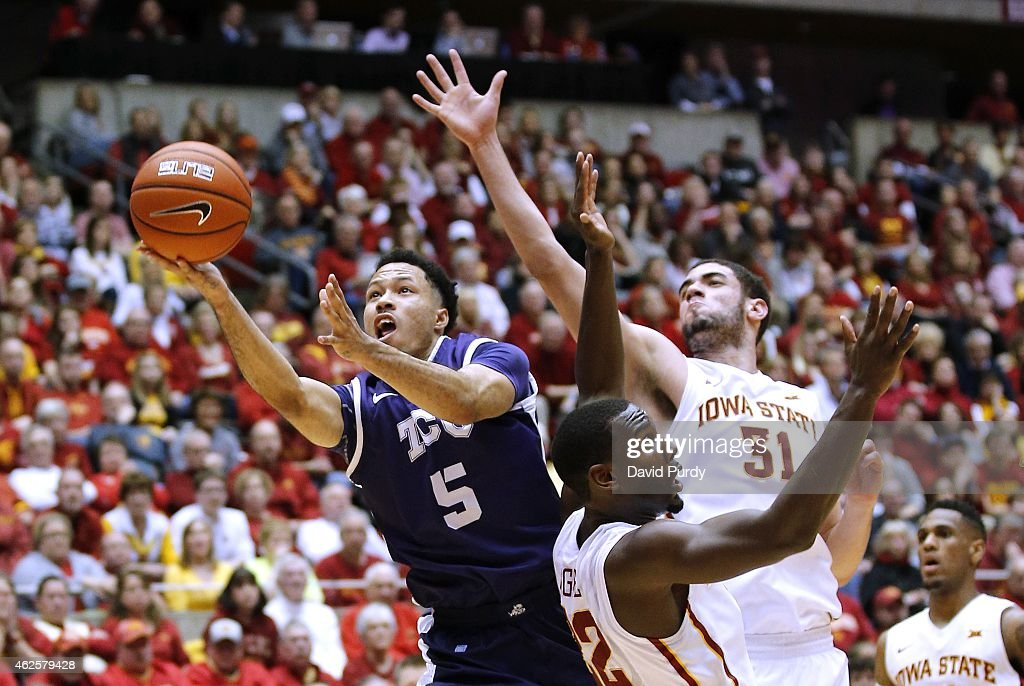 Kyan Anderson #5 of the TCU Horned Frogs takes a shot as Dustin Hogue #22, and <a gi-track='captionPersonalityLinkClicked' href=/galleries/search?phrase=Georges+Niang&family=editorial&specificpeople=10061173 ng-click='$event.stopPropagation()'>Georges Niang</a> #31 of the Iowa State Cyclones block in the second half of play at Hilton Coliseum on January 31, 2015 in Ames, Iowa. Iowa State defeated TCU