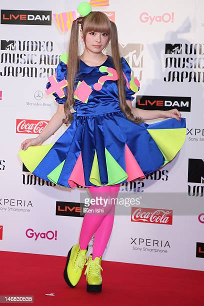 Kyary pamyu pamyu poses for photographs on the red carpet of the MTV Video Music Awards Japan 2012 at Makuhari Messe on June 23 2012 in Chiba Japan