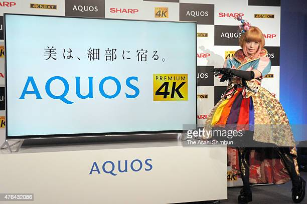 Kyary Pamyu Pamyu poses with Sharp's new Aquos Premium 4K televison on June 9 2015 in Tokyo Japan
