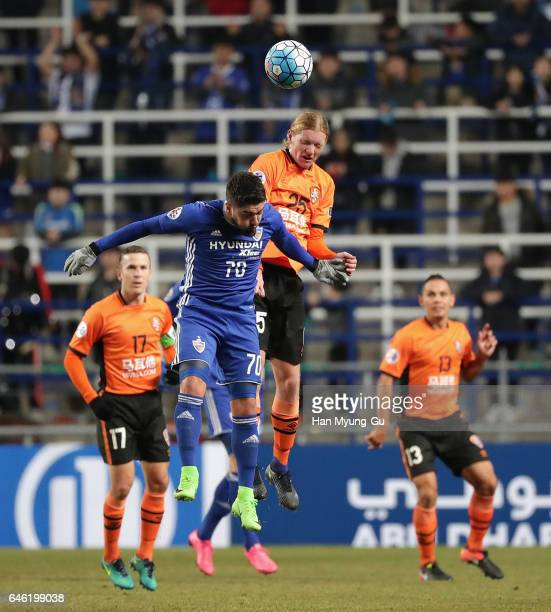 Kye Rowles of Brisbane Roar and Dimitrios Petratos of Ulsan Hyundai FC compete for the ball during the AFC Champions League Group E match between...
