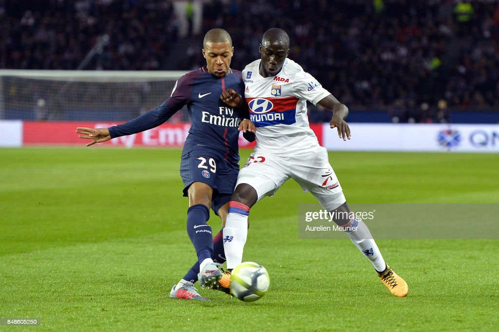 Kyian Mbappe of Paris Saint-Germain and Tanguy Ndombele of Olympique Lyonnais fight for the ball during the Ligue 1 match between Paris Saint Germain and Olympique Lyonnais at Parc des Princes on September 17, 2017 in Paris, .