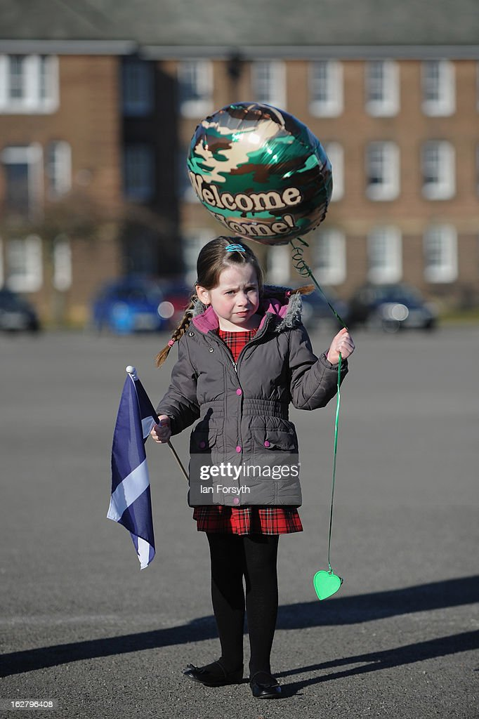 Kyla McCrindle, 5, waits for her father Pipe Major Ross McCrindle to arrive home as soldiers from Headquarters Company 1st Battalion The Scots Guards return to their base at Bourlon Barracks and are reunited with their families following their recent deployment to Afghanistan on February 27, 2013 in Catterick, England. The soldiers are the first troops from 4 Mechanized Brigade to return to their base from their tour of duty in Afghanistan where they were responsible for the training and mentoring of the Afghan national security forces.