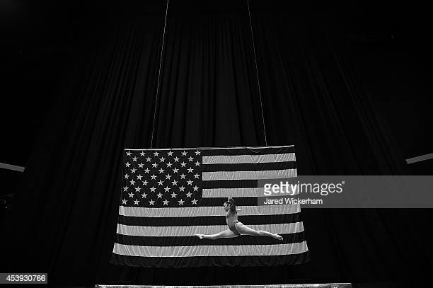 Kyla Ross competes in the balance beam section of the senior women preliminaries during the 2014 PG Gymnastics Championships at Consol Energy Center...