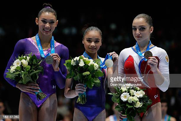 Kyla Ross of USA Huang Huidan of China and Aliya Mustafina of Russia pose with their medals in the Uneven Bars Final on Day Six of the Artistic...