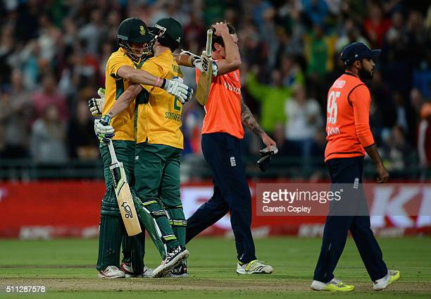 Kyle Abbott and Chris Morris of South Africa celebrate as Reece Topley of England reacts after winning the 1st KFC T20 International match between...