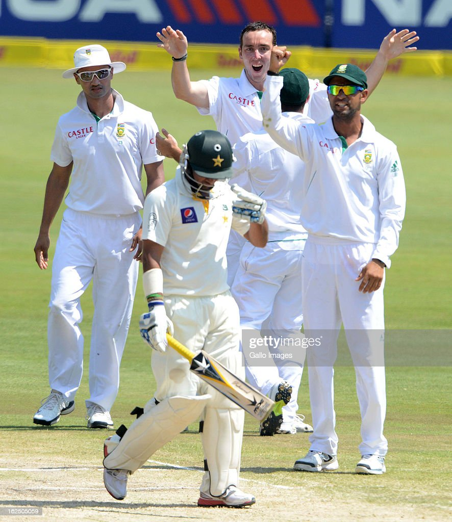 Kyle Abbott of South Africa celebrates the wicket of <a gi-track='captionPersonalityLinkClicked' href=/galleries/search?phrase=Imran+Farhat&family=editorial&specificpeople=585131 ng-click='$event.stopPropagation()'>Imran Farhat</a> of Pakistan during day 3 of the 3rd Test match between South Africa and Pakistan at SuperSport Park on February 24, 2013 in Pretoria, South Africa,