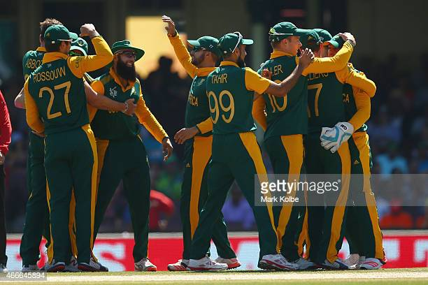 Kyle Abbott of South Africa celebrates with his team mates after taking the wicket of Thisara Perera of Sri Lanka during the 2015 ICC Cricket World...