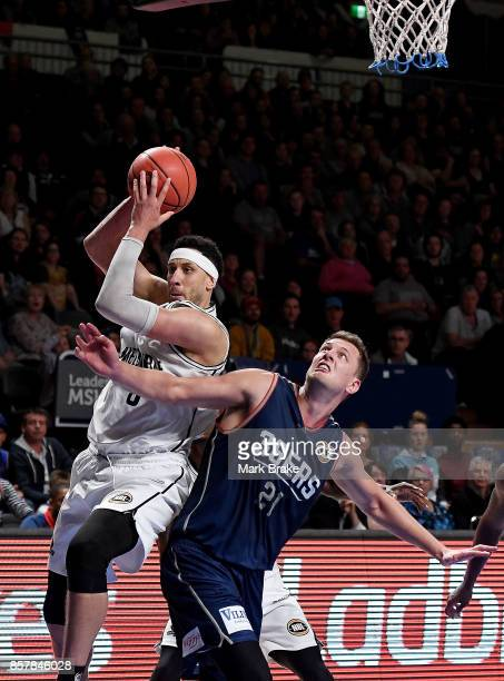 Kyle Adnam of Melbourne United and Daniel Johnson of the Adelaide 36ers during the round one NBL match between the Adelaide 36ers and Melbourne...