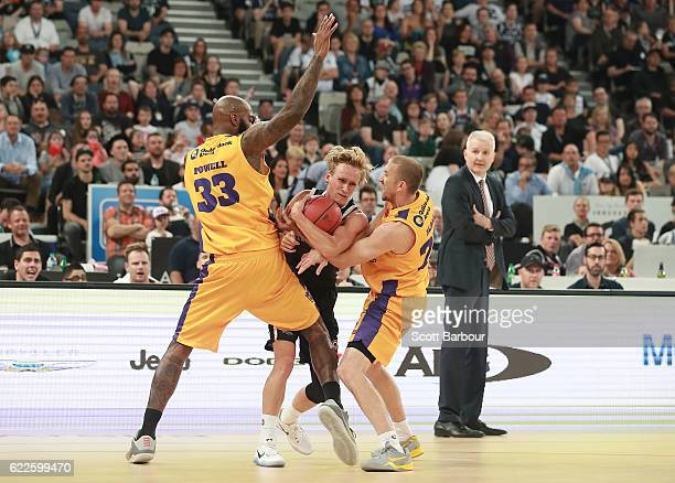 Kyle Adnam of Melbourne United and Josh Powell of the Sydney Kings compete for the ball during the round six NBL match between Melbourne United and...