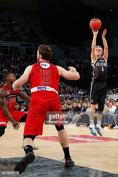 Kyle Adnam of Melbourne United shoots a three pointer during the round three NBL match between Melbourne United and the Perth Wildcats at Hisense...