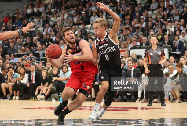 Kyle Adnam of United and Mitchell Norton of the Hawks compete for the ball during the round 18 NBL match between Melbourne United and the Illawarra...