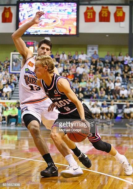 Kyle Adnam of United drives to the basket against Stephen Weigh of the Taipans during the round 15 NBL match between Melbourne United and the Cairns...