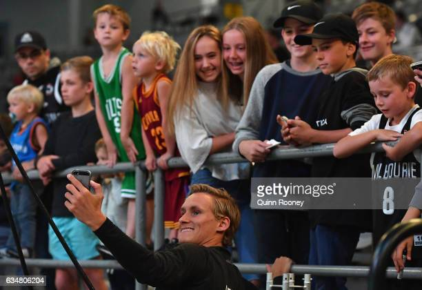 Kyle Adnam of United takes a selfie for fans during the round 19 NBL match between Melbourne United and the Perth Wildcats at Hisense Arena on...