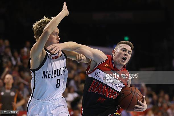 Kyle Adnam of United tries to block Rotnei Clarke of the Hawks as he drives to the basket during the round five NBL match between the Illawarra Hawks...