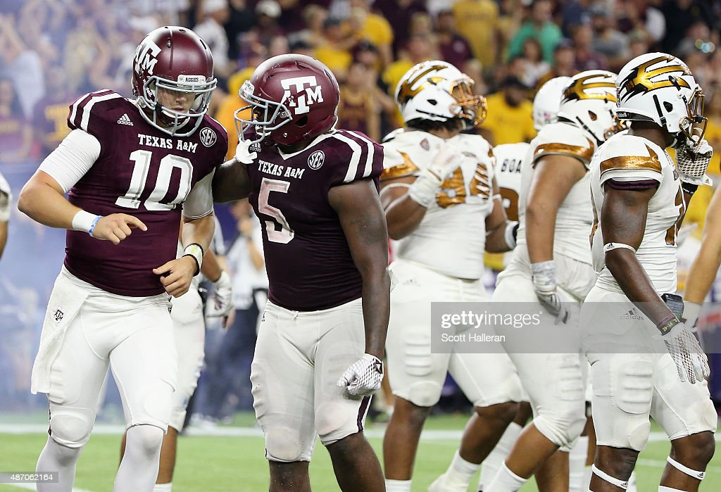 Kyle Allen and Tra Carson of the Texas AM Aggies celebate after Allen scored a touchdown in the second half of their game against the Arizona State...