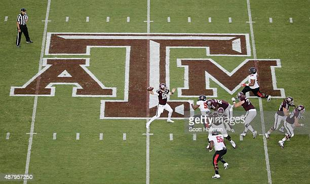 Kyle Allen of the Texas AM Aggies drops back to pass in the first half of their game against the Ball State Cardinals at Kyle Field on September 12...