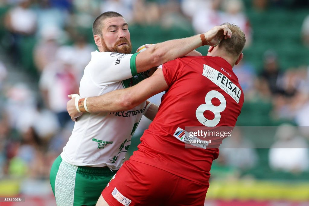 Kyle Amor of Ireland fends off Craig Kopczak of Wales during the 2017 Rugby League World Cup match between Wales and Ireland at nib Stadium on November 12, 2017 in Perth, Australia.