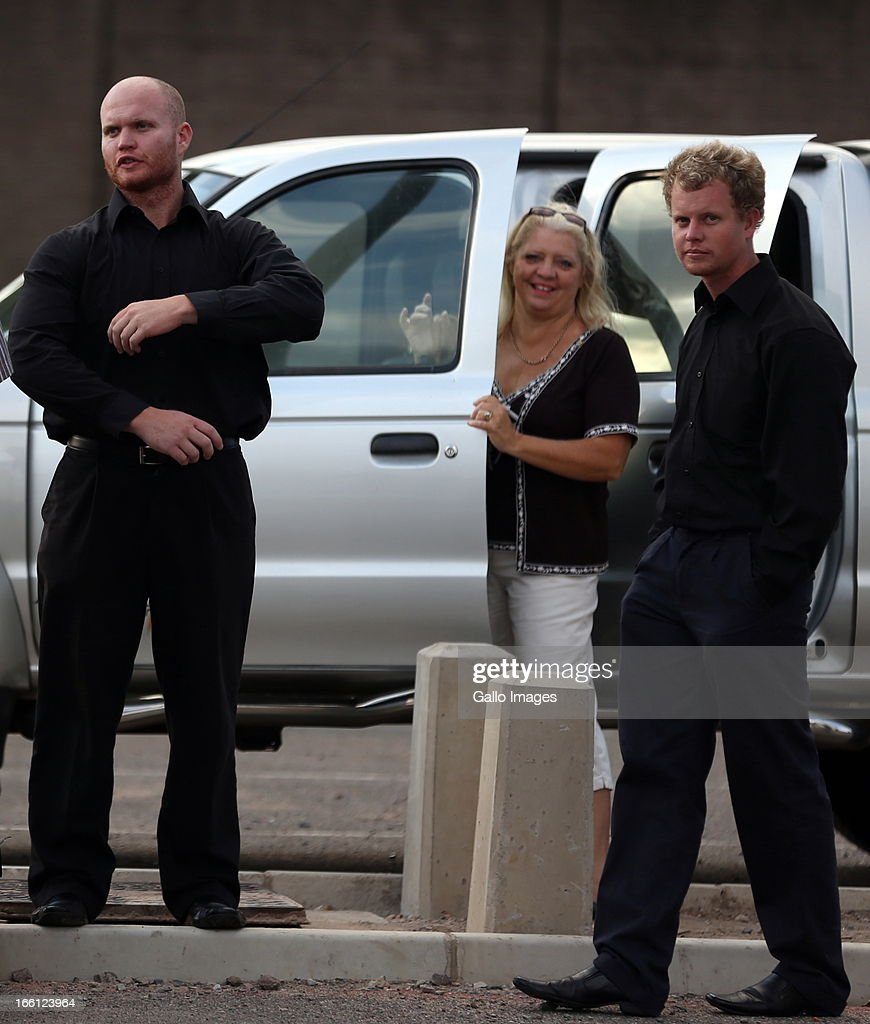 Kyle and Blayne Shepard with their mother outside court after their bail application on April 8, 2013 in Durban, South Africa. Both Shepard's have been charged with the murder of a British Royal Marine, Brett Williams. Williams was beaten to death at a Super XV Match at Durban Stadium.