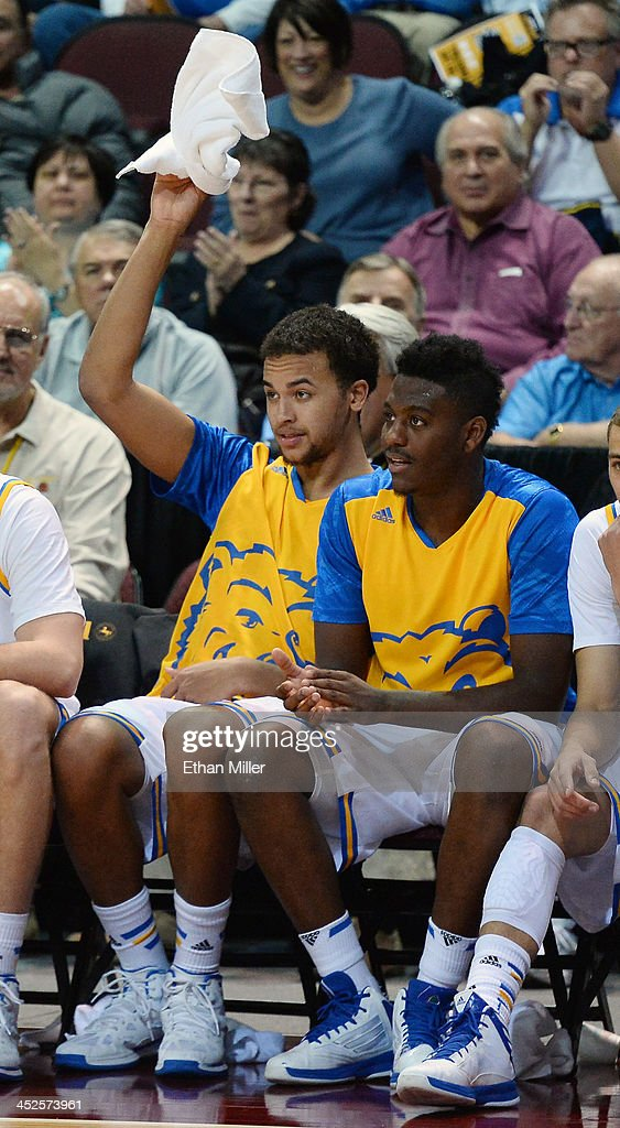 Kyle Anderson (L) #5 and Jordan Adams #3 of the UCLA Bruins cheer from the bench late in their game against the Northwestern Wildcats during the Continental Tire Las Vegas Invitational at the Orleans Arena on November 29, 2013 in Las Vegas, Nevada. UCLA won 95-79.