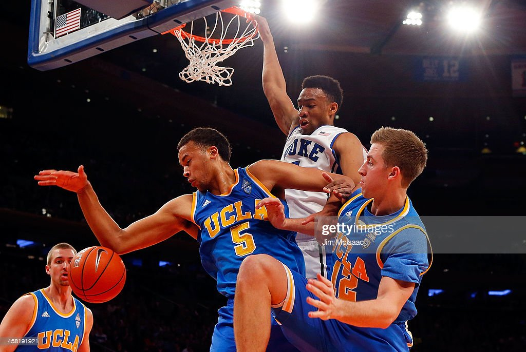 Kyle Anderson #5 and David Wear #12 of the UCLA Bruins battles for a rebound in the first half against <a gi-track='captionPersonalityLinkClicked' href=/galleries/search?phrase=Jabari+Parker&family=editorial&specificpeople=9330340 ng-click='$event.stopPropagation()'>Jabari Parker</a> #1 of the Duke Blue Devils during the CARQUEST Auto Parts Classic on December 19, 2013 at Madison Square Garden in New York City.