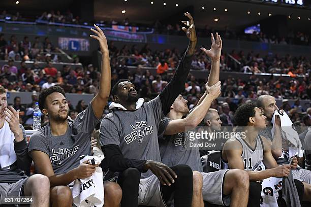 Kyle Anderson Dewayne Dedmon and David Lee of the San Antonio Spurs celebrate the Kawhi Leonard dunk during the game against the Phoenix Suns as part...