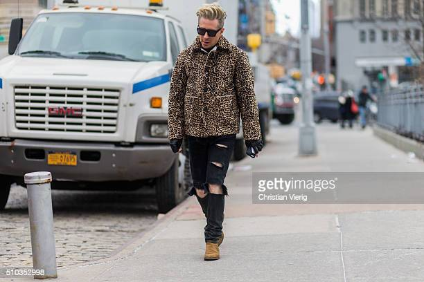 Kyle Anderson is wearing a leopard printed jacket and black ripped jeans seen outside Lacoste during New York Fashion Week Women's Fall/Winter 2016...