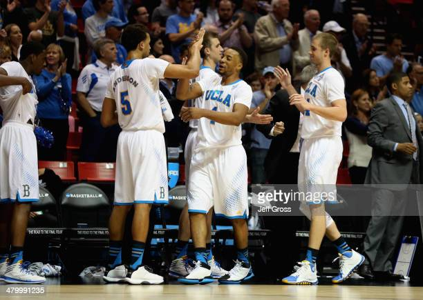 Kyle Anderson Norman Powell and Travis Wear of the UCLA Bruins celebrate their 7659 win over the Tulsa Golden Hurricane during the second round of...