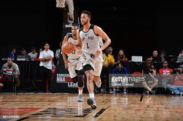 Kyle Anderson of the San Antonio Spurs brings the ball up court against the Phoenix Suns during the Las Vegas Summer League Championship on July 20...