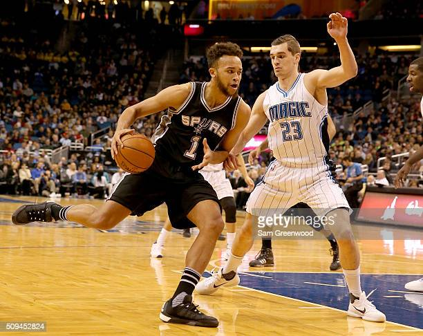 Kyle Anderson of the San Antonio Spurs drives against Mario Hezonja of the Orlando Magic during the game at Amway Center on February 10 2016 in...