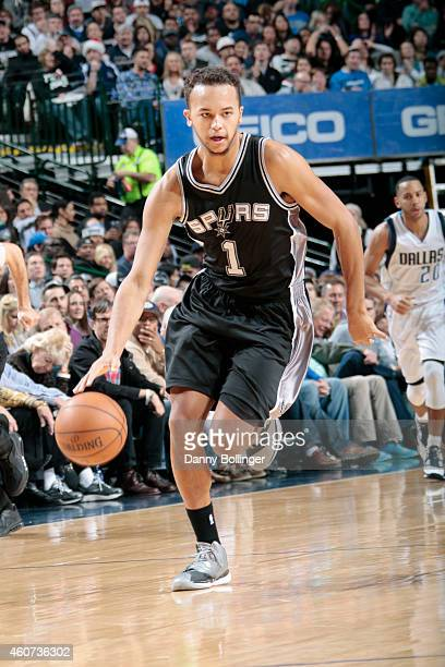 Kyle Anderson of the San Antonio Spurs drives down the court against the Dallas Mavericksduring the game on December 20 2014 at American Airlines...