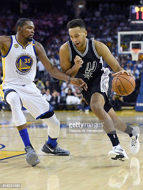 Kyle Anderson of the San Antonio Spurs drives on Kevin Durant of the Golden State Warriors during the third quarter in an NBA basketball game at...