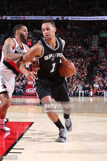 Kyle Anderson of the San Antonio Spurs drives to the basket against the Portland Trail Blazers on December 15 2014 at the Moda Center in Portland...