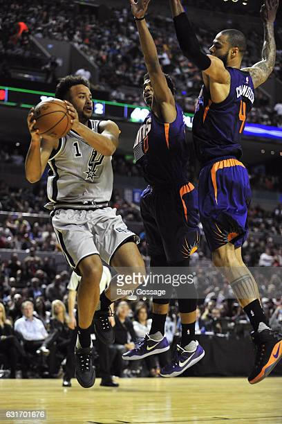 Kyle Anderson of the San Antonio Spurs drives to the basket and passes the ball against the Phoenix Suns as part of NBA Global Games at Arena Ciudad...