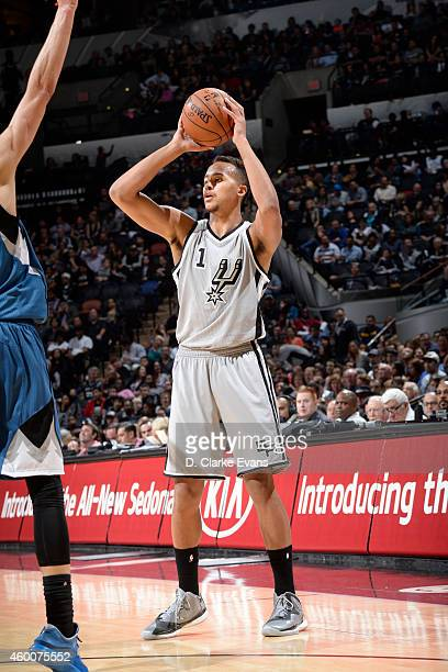 Kyle Anderson of the San Antonio Spurs handles the ball against the Minnesota Timberwolves at the ATT Center on December 6 2014 in San Antonio Texas...
