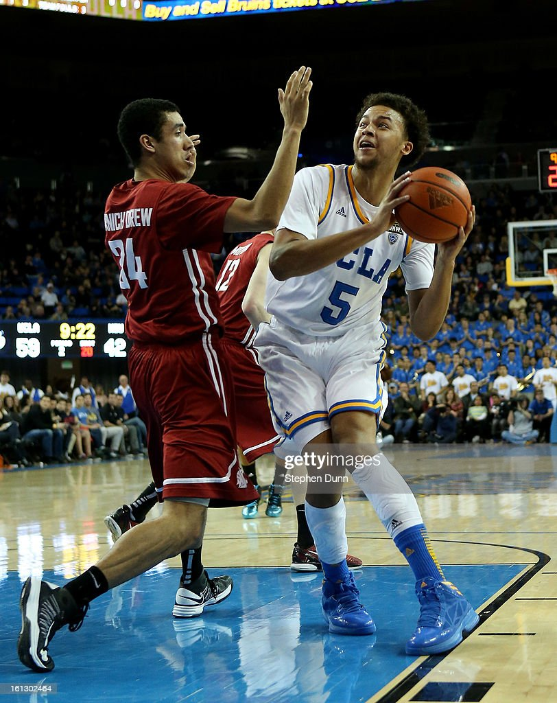 Kyle Anderson #5 of the UCLA Bruins controls the ball against Dexter Kernich-Drew #34 of the Washington State Cougars at Pauley Pavilion on February 9, 2013 in Los Angeles, California. UCLA won 76-62.