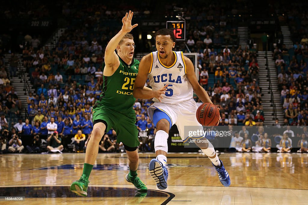 Kyle Anderson #5 of the UCLA Bruins drives against E.J. Singler #25 of the Oregon Ducks in the first half of the Pac-12 Championship game at MGM Grand Garden Arena on March 16, 2013 in Las Vegas, Nevada.
