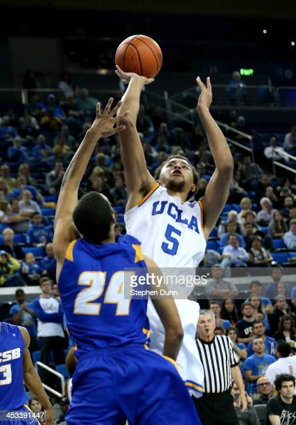 Kyle Anderson of the UCLA Bruins shoots over Michael Bryson of the UCSB Gauchos at Pauley Pavilion on December 3 2013 in Los Angeles California UCLA...