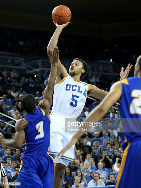 Kyle Anderson of the UCLA Bruins shoots over Zalmico Harmon of the UCSB Gauchos at Pauley Pavilion on December 3 2013 in Los Angeles California UCLA...