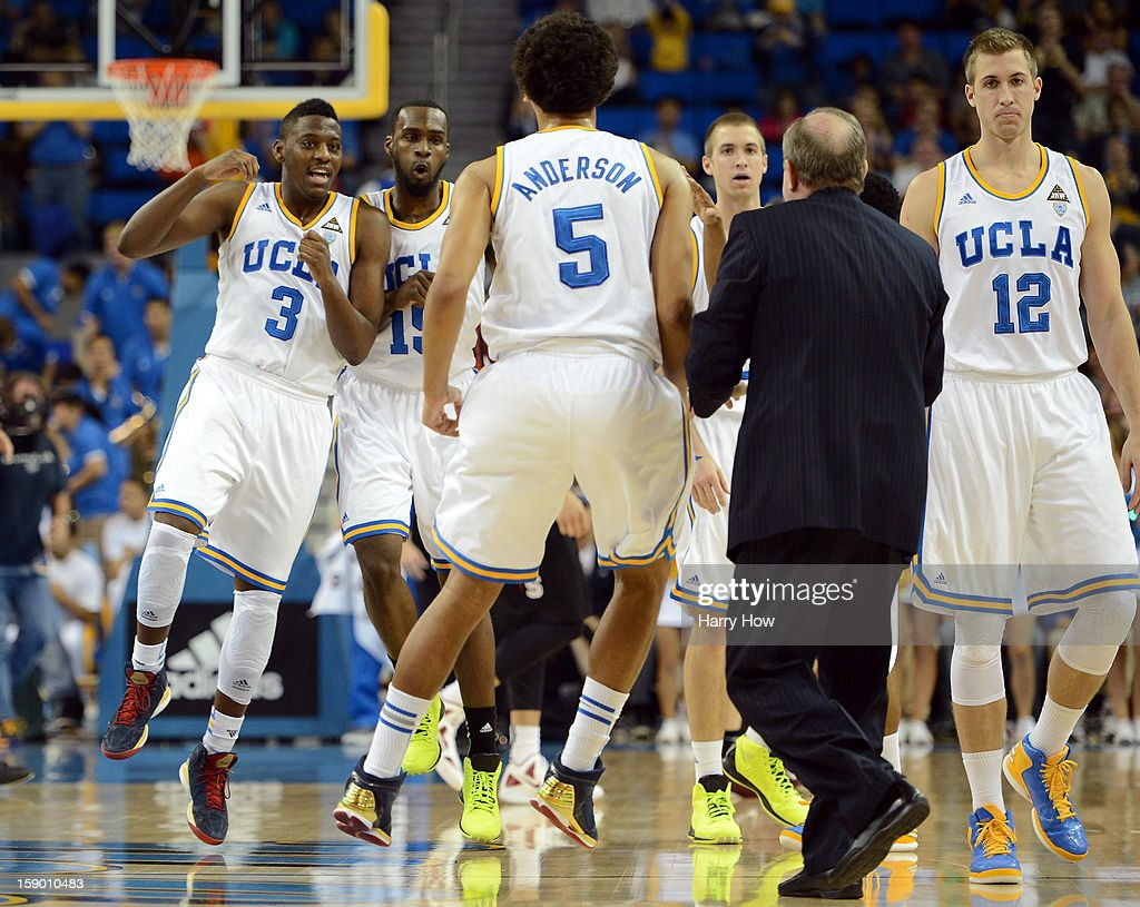Kyle Anderson #5, Shabazz Muhammad #15 and David Wear #12 of the UCLA Bruins react to a lead over Stanford Cardinal as they come off the court during a timeout at Pauley Pavilion on January 5, 2013 in Los Angeles, California. The UCLA Bruins won 68-60 over Stanford Cardinal.